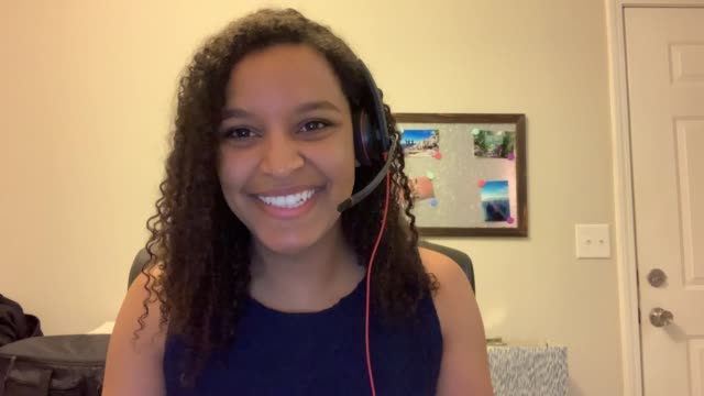 cheerful young woman listens and participates in an online meeting - webcam stock videos & royalty-free footage