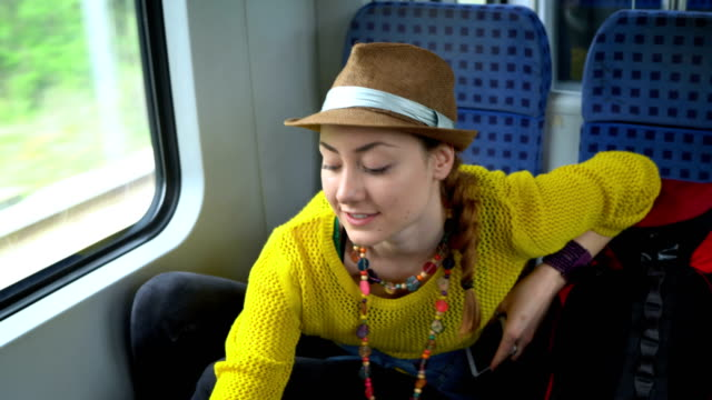 cheerful young woman travelling by train - bag stock videos & royalty-free footage