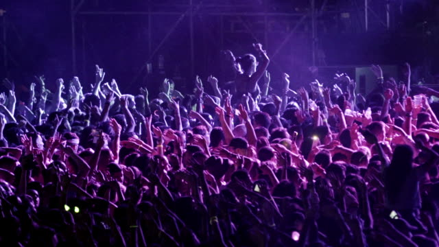 cheering crowd at a concert slo mo. - looking down stock videos & royalty-free footage