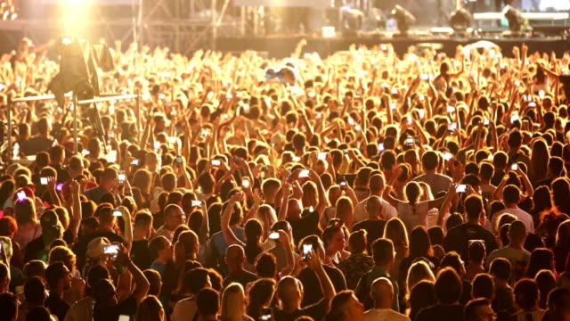 cheering crowd at a concert. - large group of people stock videos & royalty-free footage