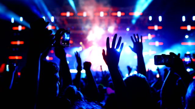 cheering crowd at a concert. - silhouette stock videos & royalty-free footage