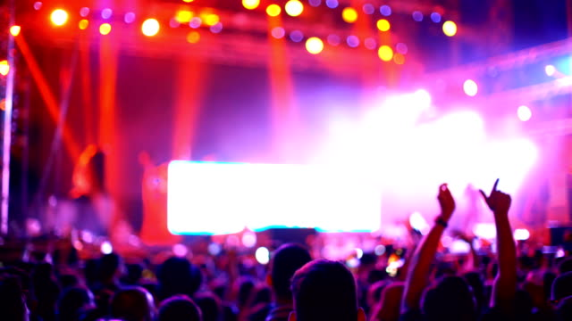cheering crowd at a concert. - entertainment event stock videos & royalty-free footage