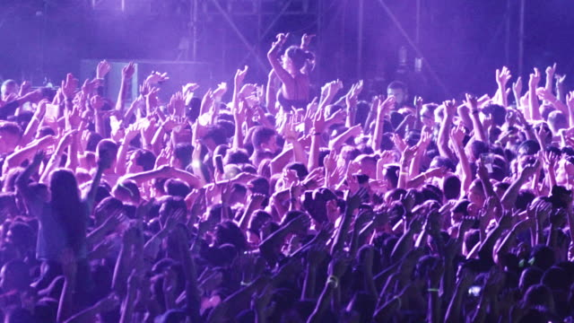 cheering crowd at a concert. - crowded stock videos & royalty-free footage