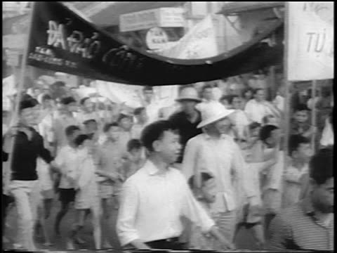 b/w 1963 cheering crowd marching with banners celebrating overthrow of diem / south vietnam / newsreel - south vietnam stock videos & royalty-free footage