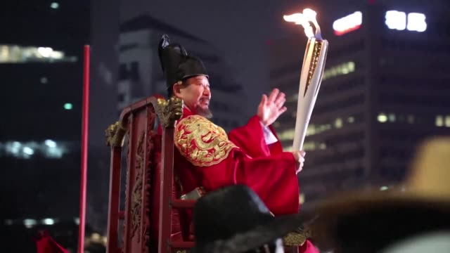 Cheering crowds welcome the Olympic flame to a freezing Seoul where the torch will be paraded for four days before making its way to Pyeongchang for...