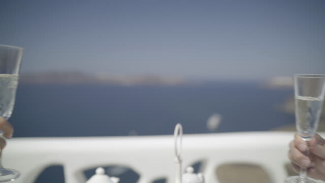 cheering with champagne at breakfast - santorini stock videos and b-roll footage