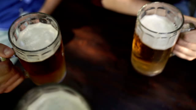 cheering,b roll,point of view - beer glass stock videos & royalty-free footage
