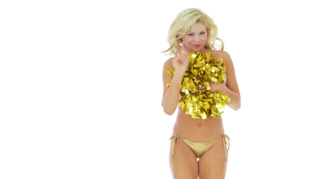 cheerleader covering breasts with pom poms - cheerleader stock videos and b-roll footage