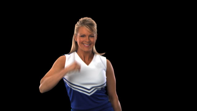 cheerleader dance routine close-up - this clip has an embedded alpha-channel - pre matted stock videos & royalty-free footage