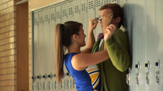 cheerleader hitting on nerd - see other clips from this shoot 1148 stock videos and b-roll footage