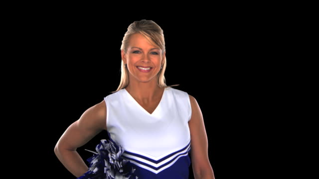 cheerleader smiling - this clip has an embedded alpha-channel - pre matted stock-videos und b-roll-filmmaterial