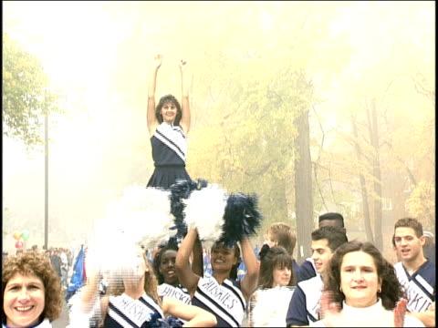 cheerleaders at connecticut parade - チアリーダー点の映像素材/bロール