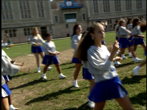 stockvideo's en b-roll-footage met cheerleaders doing a dance routine - 1993