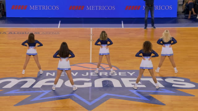 cheerleaders leaving the basketball court after their performance - cheerleader stock videos & royalty-free footage