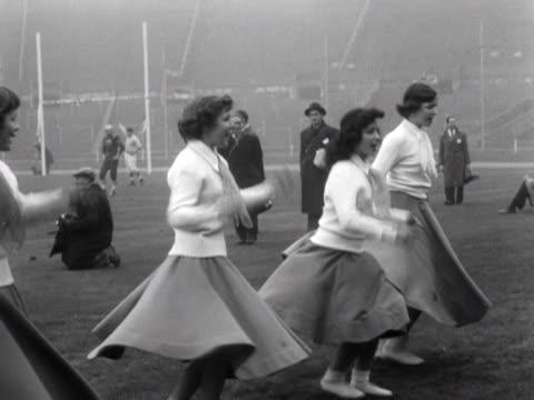 cheerleaders perform a routine at an american football game at wembley stadium - cheerleader stock videos & royalty-free footage