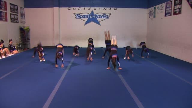 cheerleaders perform a routine - cheerleader stock videos & royalty-free footage