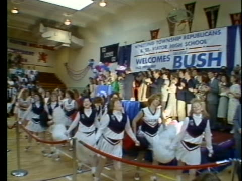 cheerleaders perform and supporters wave signs at a political rally for george h. w. bush in chicago. - cheerleader stock videos & royalty-free footage