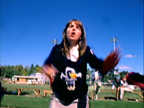 handheld cheerleaders performing next to football field / mill valley, california, united states - cheerleader stock videos and b-roll footage