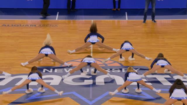cheerleaders performing their pom pom routine during half-time - pom pom stock videos & royalty-free footage
