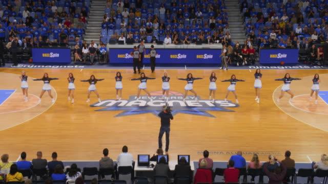 cheerleaders performing their routine on the basketball court - cheerleader stock videos & royalty-free footage