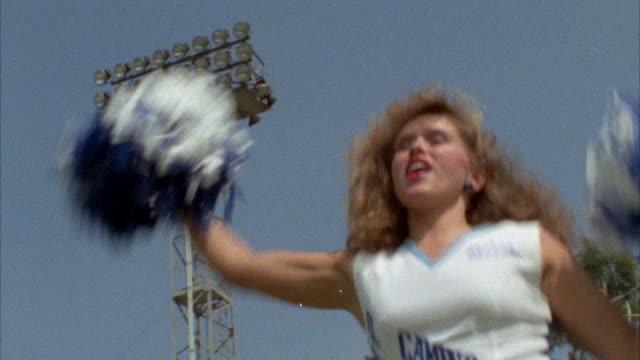 vídeos y material grabado en eventos de stock de ms cheerleaders showing cheer dance - rizado peinado