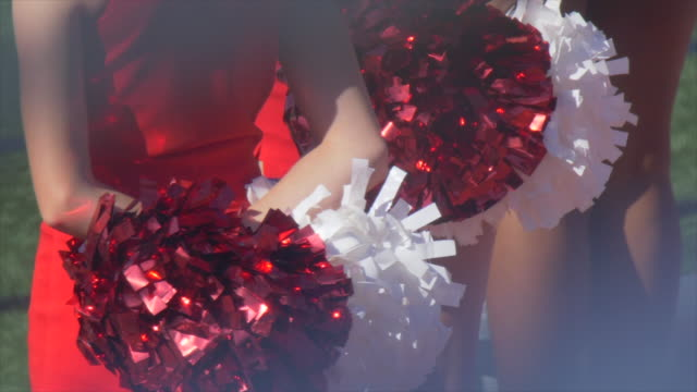 cheerleaders with pom-poms at an american football game. - slow motion - cheerleader stock videos & royalty-free footage