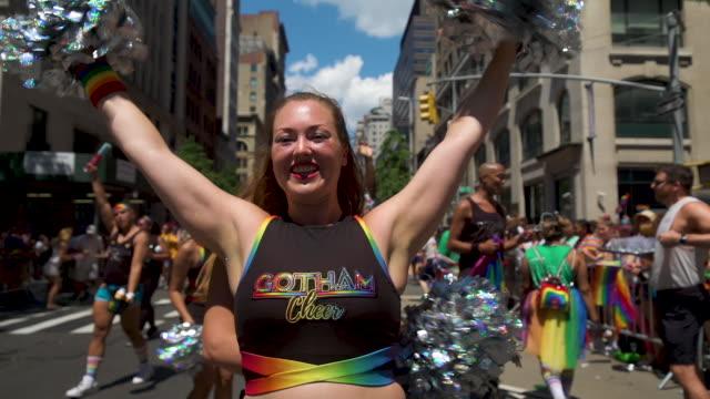 cheerleading at pride march worldpride nyc 2019 on june 30 2019 in new york city - チアリーダー点の映像素材/bロール