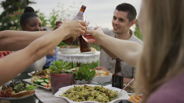 cheers during an outdoor dinner party - patio stock videos & royalty-free footage