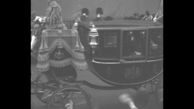 [vo cheers throughout] montage royal glass coach bearing prince george edward the prince of wales and albert the duke of york leaves st james's... - prince stock videos and b-roll footage