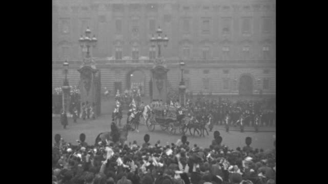 cheers throughout] royal carriage bearing king george v and queen mary approaches as it leaves buckingham palace; crowds cheer, wave; members of the... - archbishop of canterbury stock videos & royalty-free footage