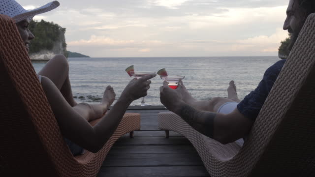 cheers, we found our paradise - deck chair stock videos & royalty-free footage