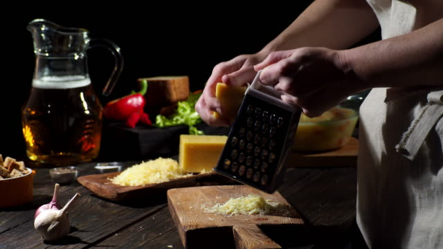 cheese and beer soup - grater utensil stock videos & royalty-free footage
