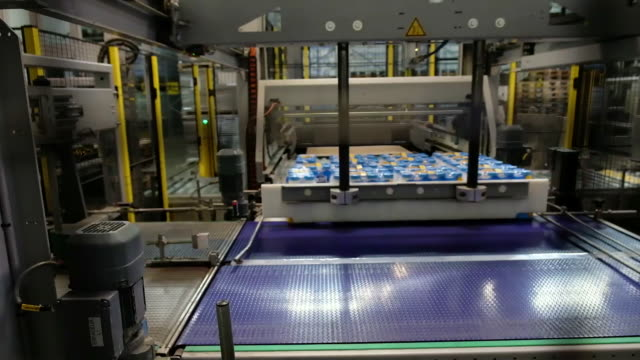 cheese and organic milk production in different processes at the soiciete fromagere de rodez part of groupe lactalis in rodez france on monday jan 27... - milk bottle stock videos & royalty-free footage