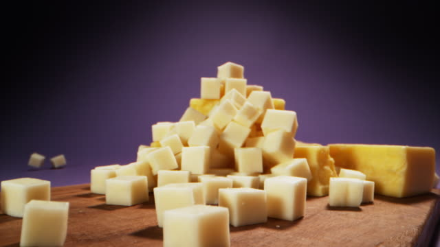 cheese cubes falling down - block shape stock videos & royalty-free footage