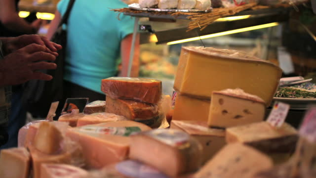 cheese offered at the open market - frische stock videos & royalty-free footage