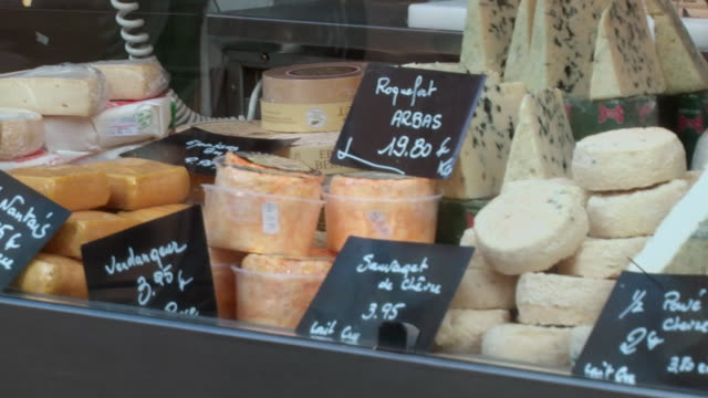 ms pan cheese on display in window of cheese store / paris, france  - cheese stock videos & royalty-free footage