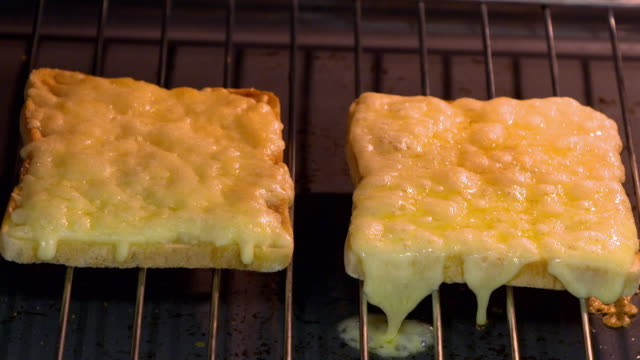 cheese on toast being prepared and grilled - cheese stock videos & royalty-free footage