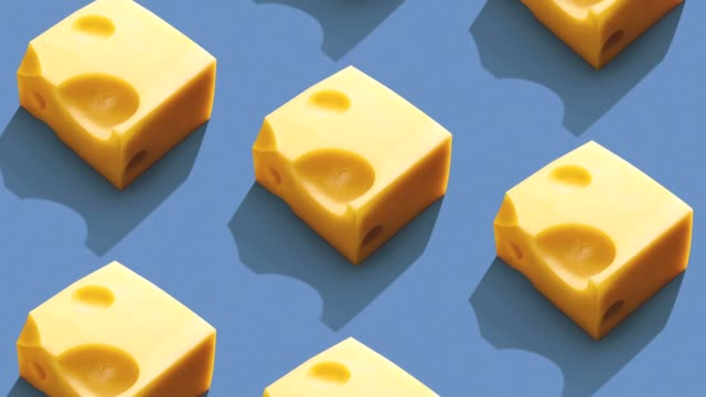 cheese pattern on color background. - still life stock videos and b-roll footage