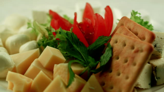 cheese plate. vegetarian snack - cracker stock videos and b-roll footage
