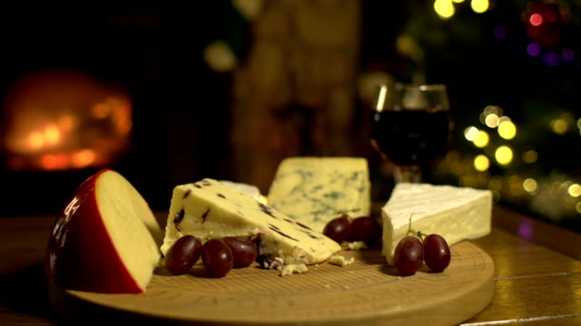 cheeseboard and wine at christmas with fireplace, dolly - cheese stock videos and b-roll footage