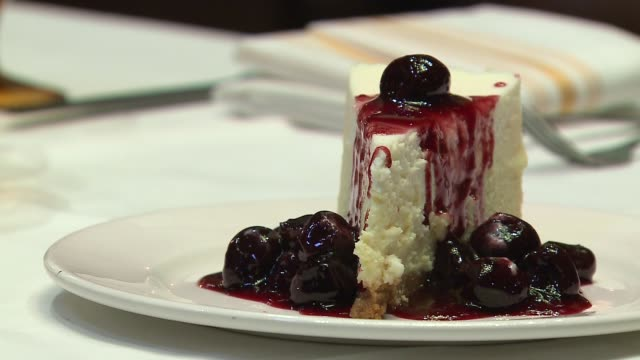 wgn cheesecake doused with sauteed and flamed cherries at the evanston illinois restaurant the barn on jan 11 2017 - saute stock videos and b-roll footage