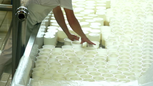 Cheesemaker Turning The Ricotta Moulds