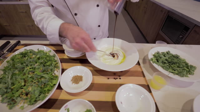 chef adds balsamic vinegar to a salad dressing - quinoa salad stock videos & royalty-free footage