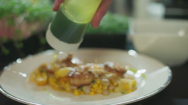 cu chef adds finishing touches to gourmet meal - silver service stock videos & royalty-free footage