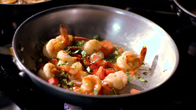 a chef adds seasonings to a skillet. - seafood stock videos & royalty-free footage