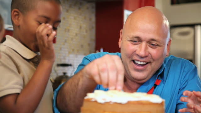 cu pan chef and children (6-11) decorating cake / los angeles, california, usa - cake stock videos & royalty-free footage