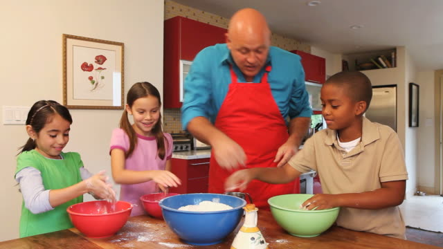 MS Chef and children (6-11) making dough / Los Angeles, California, USA