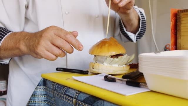 Chef Assembling Bacon Cheeseburger
