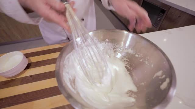 a chef beating eggs into a meringue - meringue stock videos & royalty-free footage