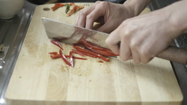 chef chop red chilli pepper finely